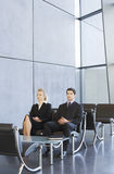 Two job candidates sitting in a waiting room Royalty Free Stock Photo