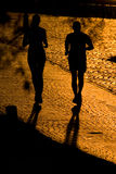 Two joggers silhouettes Stock Photos