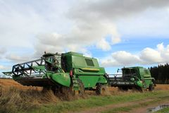 Two John Deere Combine Harvesters by Field royalty free stock images
