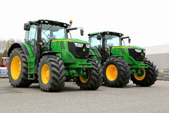 Two John Deere 6210R Agricultural Tractors on a Yard. Royalty Free Stock Photo