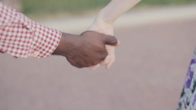 Two joining hands, International friendship theme. Two interracial lovers joining hands stock video footage