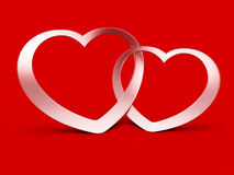 Two jointed hearts on red Stock Photo