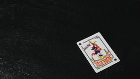 Two jokers on the table. black background stock image