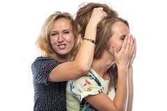 Two joking fun sisters Stock Images