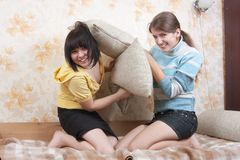 Two joy girl on sofa Royalty Free Stock Photos