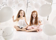 Two joyful girls playing together Royalty Free Stock Photography