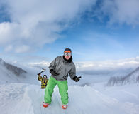 Two joyful snowboarder in the mountains Stock Images