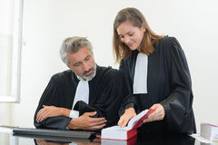 Two judges looking at law book Royalty Free Stock Photos