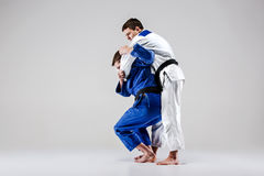 The two judokas fighters fighting men Royalty Free Stock Photo