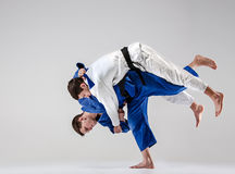 The two judokas fighters fighting men Royalty Free Stock Images