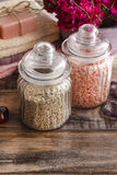 Two jugs with sea salts on wooden table Royalty Free Stock Photography
