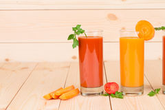 Two juices of tomato and carrot. Stock Images