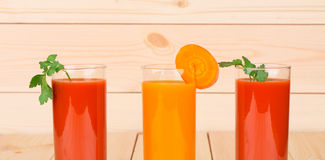 Two juices of tomato and carrot. Stock Photos