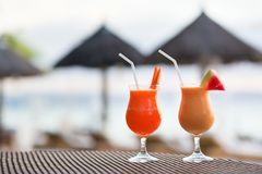 Two juices on a tropical beach Stock Photos