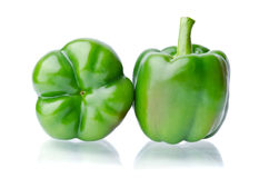 Two juicy green peppers Stock Images