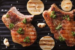 Two juicy grilled pork steak in a pan grill  horizontal top view Stock Photography