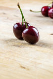Two juicy healthy ripe red cherries Royalty Free Stock Photography