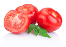 Two Juicy Red tomatoes and half with leaves Isolated Stock Images