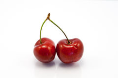 Two juicy ruby red cherries Royalty Free Stock Photo