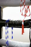 Two jump ropes hang at the corner of a boxing ring Royalty Free Stock Photo