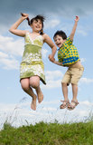 Two jumping children. Little brother and big sister Royalty Free Stock Photo