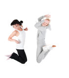 Two jumping fitness instructors isolated on white. Shoot of two jumping fitness instructors isolated on white Royalty Free Stock Image