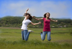 Two jumping girls Royalty Free Stock Photo