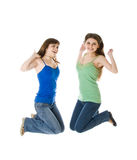 Two jumping girls Royalty Free Stock Images