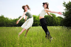 Two jumping girls on blue sky Stock Photo