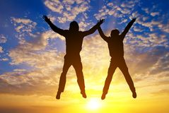 Two jumping people silhouette Stock Image