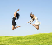 Two jumping woman Royalty Free Stock Photo