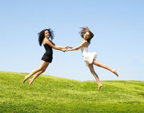 Two jumping woman Stock Image