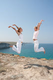 Two jumping women Royalty Free Stock Image