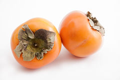 Two kaki fruits Stock Photography