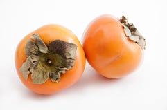 Two kaki fruits Stock Photography