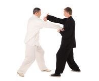 Two karate fighters. Training fight. Royalty Free Stock Image