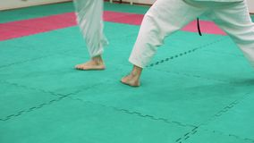 Two karate players compete in the ring 4k. Two karate players compete in the ring stock footage