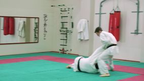Two karate players compete in the ring 4k stock video