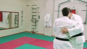 Two karate players compete in the ring 4k. Two karate players compete in the ring stock video