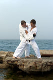 Two karateka fight Royalty Free Stock Image