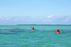 Two kayakers in the huge lagoon of Tahaa Royalty Free Stock Photo