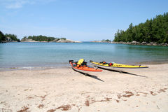 Two Kayaks on the Beach. Two sea kayaks on the beach at Sinclair Cove. Lake Superior Provincial Park, Ontario Stock Photography