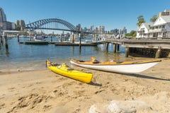 Two kayaks on beach Lavender Bay Stock Photos