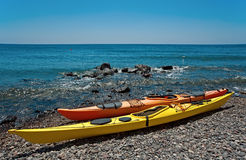 Two kayaks on the beach of Santorini, Greece Royalty Free Stock Photography