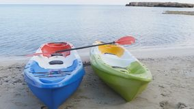 Two kayaks on the beach. Two sea kayaks on the beach stock footage