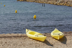 Two kayaks in the beach Stock Photo