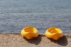 Two kayaks in the beach Stock Photos