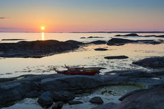 Two kayaks on a cliff sunset Royalty Free Stock Photos