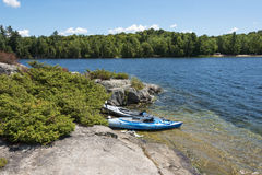 Two Kayaks on an Island Stock Images