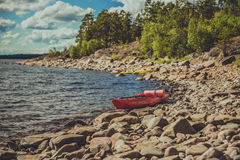 Two kayaks on the lake. Extreme tourism on the lake. Kayaks landing on the coast Stock Photos